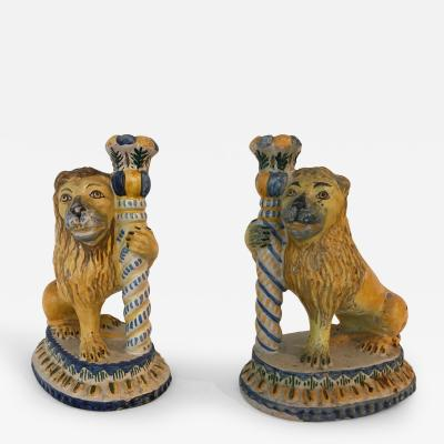 A Rare Pair of Faience Candlesticks