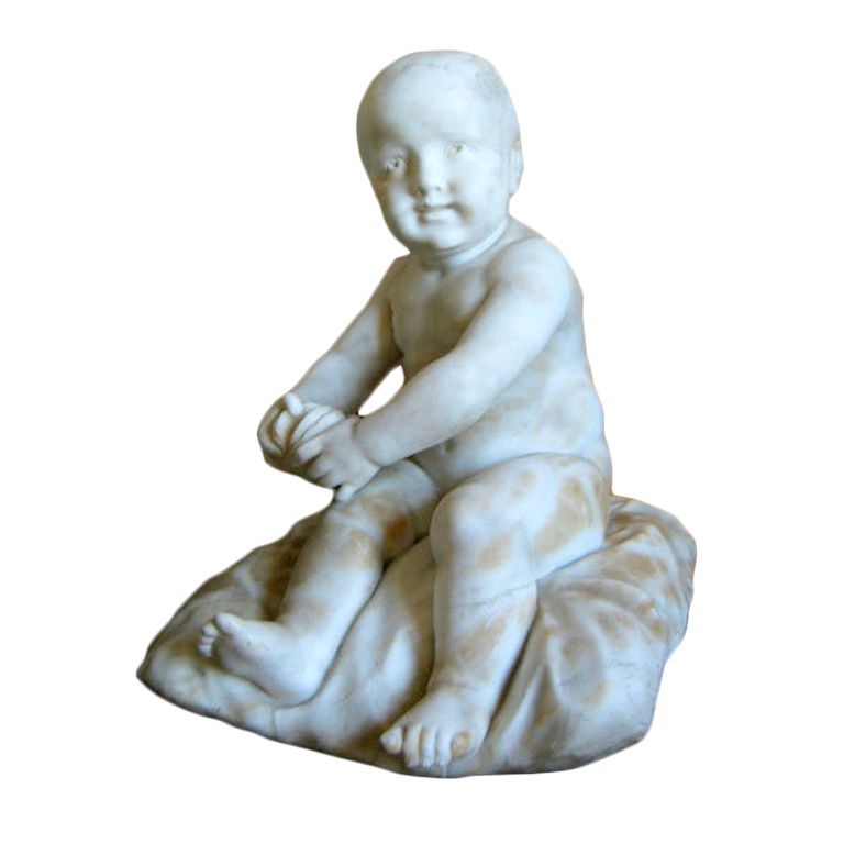 An Italian Alabaster Sculpture of a Boy Seated on a Cushion Holding an Orange.